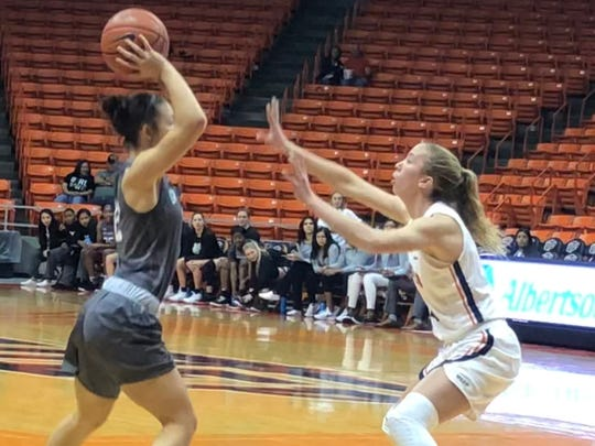 UTEP's Avery Crouse (right) guards Eastern New Mexico's Zamorye Cox during Saturday's exhibition at the Don Haskins Center
