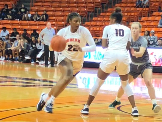 DeJaNae Roebuck drives to the basket against Eastern New Mexico Saturday at  the Don Haskins Center