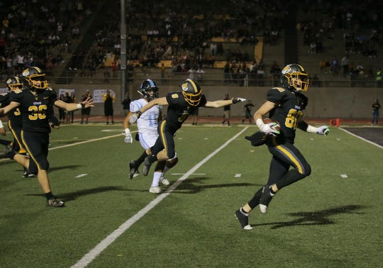 Ventura High's Zack Rodriguez heads for the end zone to score the Cougars' second touchdown on a punt return during the first quarter of Friday night's game against rival Buena. The host Cougars won, 49-28.