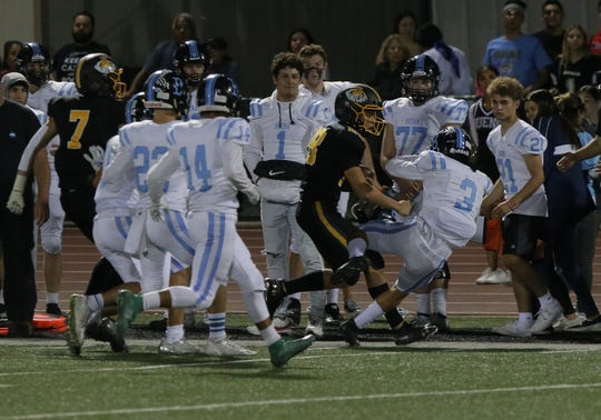 Ventura High's Dane Kapler knocks Buena's Matt Sanchez off his feet as he heads for the sidelines during the second quarter of Friday night's rivalry showdown. Ventura won, 49-28, to run their winning streak againstits city rival to 10 games.