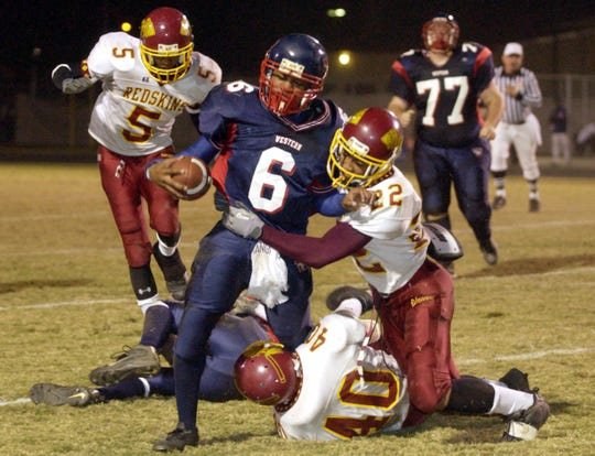 Tulare Union's Jonte Lewis tackles James Brown of Tulare Western at the 39th Victory Bell game at Bob Mathias Stadium Friday, November 7, 2003.