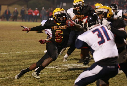 Tulare Union running back Romello Harris (6) Friday during the 50th Bell Game at Mathias Stadium in Tulare.