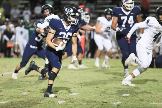 Redwood;s Caden Shafer (26) rushes against El Diamante in a West Yosemite League High School Football game at Mineral King Bowl on Friday Oct 25th, 2019.