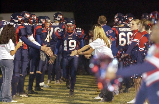 Tulare Western's Victor Ramirez enters Bob Mathias Stadium at the 39th Victory Bell game Friday, November 7, 2003.