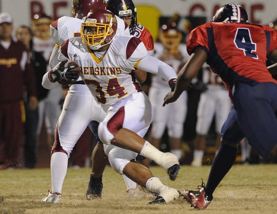 Tulare Union's Xavier Stephens (34) runs against Tulare Western in the annual Bell game at Mathias Stadium in 2011.