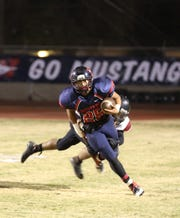 Tulare Western's Corey Juarez (25) runs against Tulare Union during the Bell game at Bob Mathias Stadium Friday night in 2013.