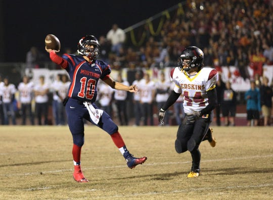 Tulare Western's Kobe Portillo (10) passes against Tulare Union's Jace Pimentel (14) during the Bell game at Bob Mathias Stadium Friday night in 2013.
