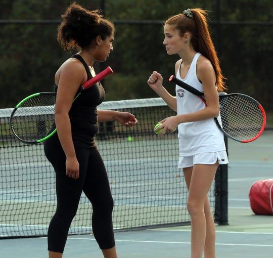 Harrison's Deana Giambo and partner Jess Saviano talk during a break against Byram Hills' Ellie Margolin and Alyssa Margolin during Section 1 girls tennis championships at Harrison High School on Oct. 25, 2019.