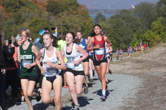 The girls varsity race goes up a hill at the annual Westchester County Cross-Country Championship at Croton Point Park in Croton Oct. 26, 2019.