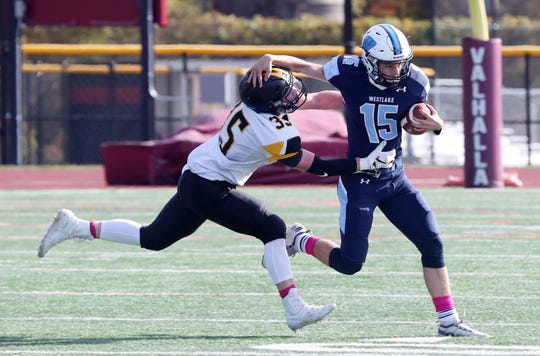 Westlake's Jason Ausiello (15) tries to  breaks away from Nanuet's Tim Ryan (35) on a first half run during playoff football action at Valhalla High School Oct. 26, 2019.
