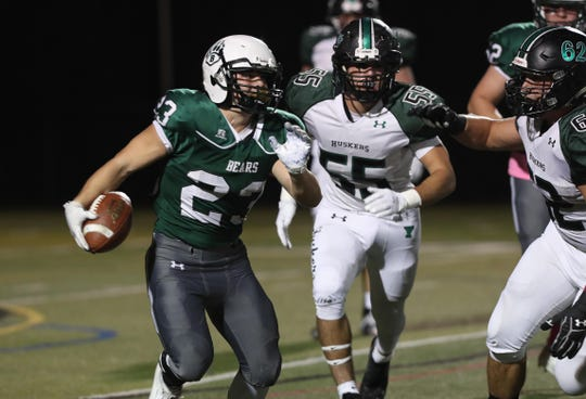 Brewster's Tom Consolato (23) looks for some room in the Yorktown defense, during football playoff acton at Brewster High School Oct. 25, 2019.