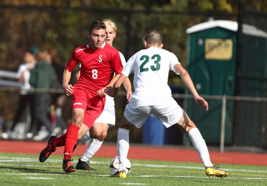 Somers' Bennett Lietner (8) works an assist during their Class A boys soccer quarterfinal game against Yorktown at Somers High School in Lincolndale on Saturday, October 26, 2019.