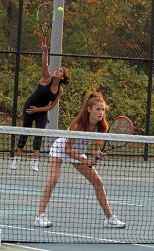 Harrison's Deana Giambo serves with her partner Jess Saviano against Byram Hills'ÊEllie Margolin and Alyssa Margolin during Section 1 girls tennis championships at Harrison High School on Oct. 25, 2019.