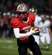 Somers' Charlie Balancia runs for a touchdown during a Class A quarterfinal with Clarkstown North at Somers, Oct. 25, 2019. Somers won 35-0.