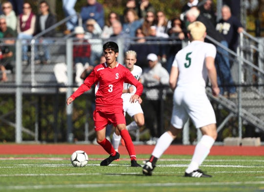 Somers' Diego Giron (3) centers a pass during their Class A boys soccer quarterfinal game against Yorktown at Somers High School in Lincolndale on Saturday, October 26, 2019.