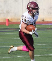 Arlington's Richie Finn carries the ball  during their Section One Class AA Quarterfinal football game against New Rochelle High School in New Rochelle, Oct 26, 2019.