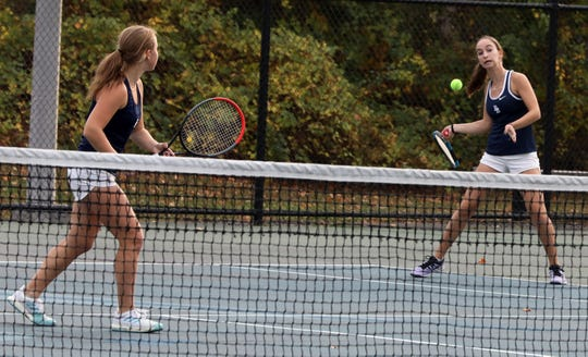 Byram Hills'ÊAlyssa Margolin and Ellie Margolin return the ball to Harrison's Deana Giambo and Jess Saviano during Section 1 girls tennis championships at Harrison High School on Oct. 25, 2019.