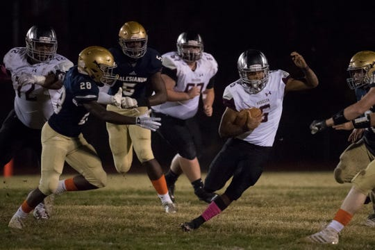Hodgson's Curt Henry finds a hole in the Salesianum defense Friday night.