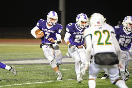 Jacksboro quarterback Landon Davenport runs the ball as the Tigers host the Dublin Lions Friday, October 25, 2019.
