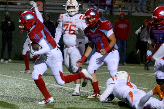 Hirschi's KD Dorsey breaks the tackle on a rainy Friday night as the Huskies hosted the Burkburnett bulldogs.