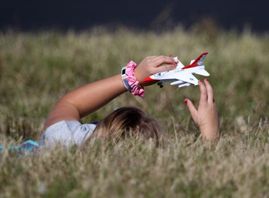 A young girl plays with a toy plane Saturday, Oct. 26, 2019, at the Sheppard Air Force Base Open House and Air Show.