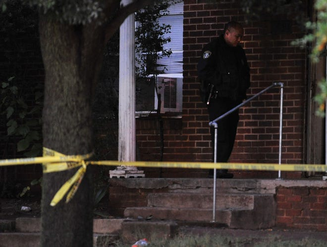 Wichita Falls police work the scene of an early Saturday morning homicide on Warford St.
