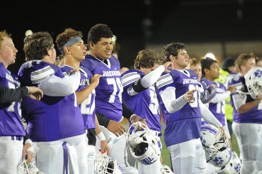 Jacksboro players line up for the fight song after taking the lead in District 6-3A Division II following their defeat of Dublin 23-16 Friday night.