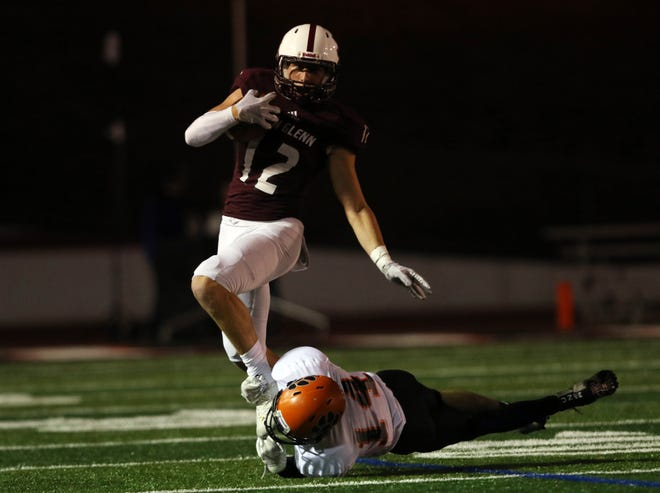 A New Lexington defender trips up John Glenn's Reece Perkins in a game earlier this season. Perkins was named a first-team All-Ohio receiver in Division IV.