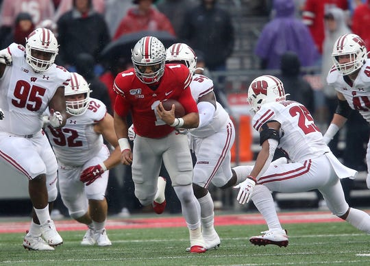 Ohio State quarterback Justin Fields finds running room during the first quarter against Wisconsin at Ohio Stadium.