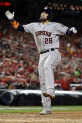 Astros' Robinson Chirinos celebrates after his home run in the sixth inning.
