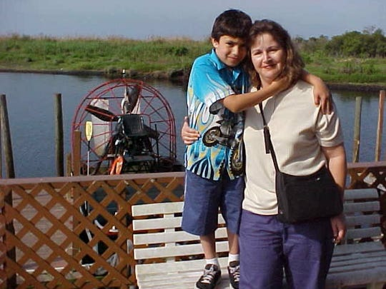 Joan Majid is pictured with her son, Adam, when he was about 8 and the two had been for an airboat ride. Adam died in 2005 at age 11 after battling cancer.
