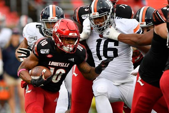 Louisville Cardinals running back Javian Hawkins (10) of Cocoa High runs the ball against Virginia Cavaliers defensive end Richard Burney (16) during the second half of play at Cardinal Stadium. Louisville defeated Virginia 28-21.