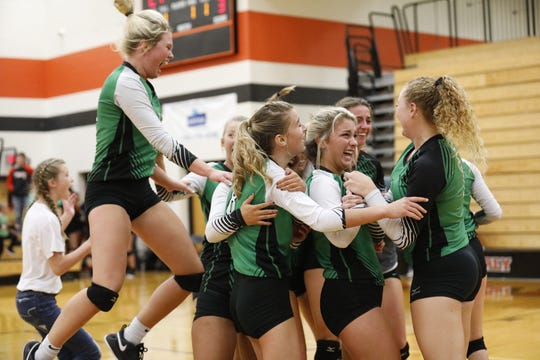 Huntington volleyball celebrates after winning a Division III District Final 3-1 over Westfall on Saturday Oct. 26, 2019 at Waverly High School in Waverly, Ohio.