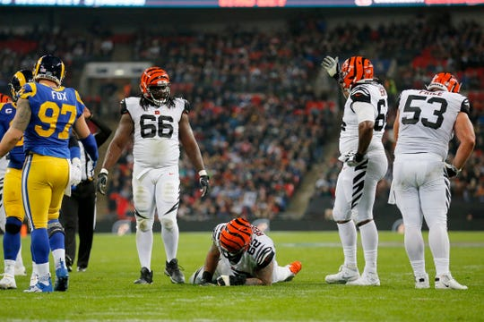 Cincinnati Bengals middle linebacker Preston Brown (52) stays down after being injured on a play in the fourth quarter of the NFL Week 8 game between the Los Angeles Rams and the Cincinnati Bengals at Wembley Stadium in Wembley, London, on Sunday, Oct. 27, 2019. The Bengals lost 24-10, advancing to 0-8 on the season.