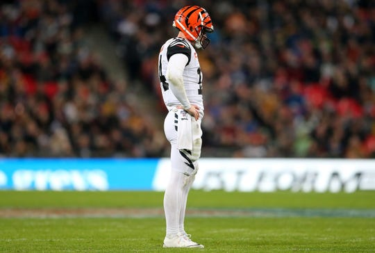Cincinnati Bengals quarterback Andy Dalton (14) reacts after an incomplete pass in the fourth quarter of a Week 8 NFL game against the Los Angeles Rams, Sunday, Oct. 27, 2019, at Wembley Stadium in London, England. The Los Angeles Rams won 24-10.