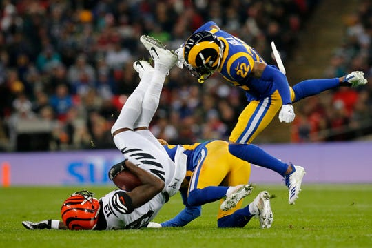 Cincinnati Bengals wide receiver Auden Tate (19) is brought down after a catch in the second quarter of the NFL Week 8 game between the Los Angeles Rams and the Cincinnati Bengals at Wembley Stadium in Wembley, London, on Sunday, Oct. 27, 2019.