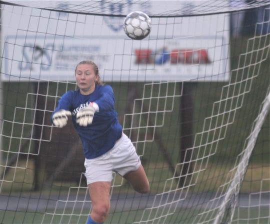 Highlands senior Lauren Deckert makes a crucial penalty kick save Oct. 26.