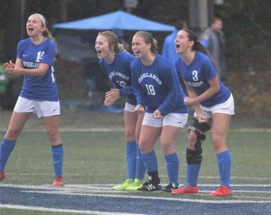 Highlands players in the PK shootout cheer on Lauren Deckert.