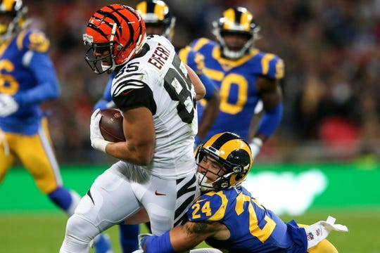 Cincinnati Bengals tight end Tyler Eifert (85) completes a catch as Los Angeles Rams safety Taylor Rapp (24) makes a tackle in the first quarter of a Week 8 NFL game, Sunday, Oct. 27, 2019, at Wembley Stadium in London, England. The Los Angeles Rams lead 17-10 at halftime.