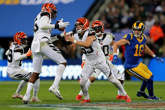 Cincinnati Bengals defensive end Carlos Dunlap (96) and Cincinnati Bengals outside linebacker Nick Vigil (59) are unable to secure an interception in the third quarter of a Week 8 NFL game,Sunday, Oct. 27, 2019, at Wembley Stadium in London, England. The Los Angeles Rams won 24-10.