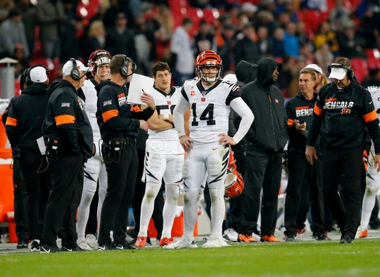 Cincinnati Bengals quarterback Andy Dalton (14) watches as a touchdown is reviewed and eventually overturned in the fourth quarter of the NFL Week 8 game between the Los Angeles Rams and the Cincinnati Bengals at Wembley Stadium in Wembley, London, on Sunday, Oct. 27, 2019. The Bengals lost 24-10, advancing to 0-8 on the season.