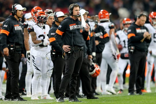 Cincinnati Bengals head coach Zac Taylor calls in a play in the fourth quarter of a Week 8 NFL game against the Los Angeles Rams, Sunday, Oct. 27, 2019, at Wembley Stadium in London, England. The Los Angeles Rams won 24-10.