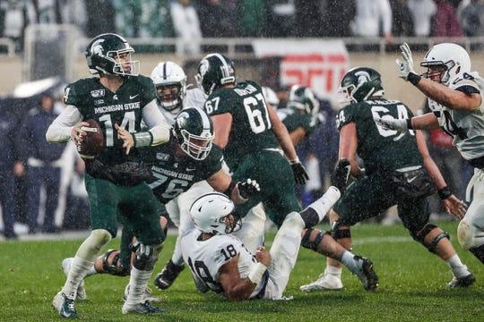 Freshman J.D. Duplain (67) blocks as Michigan State quarterback Brian Lewerke looks to pass against Penn State during Saturday's second half at Spartan Stadium.