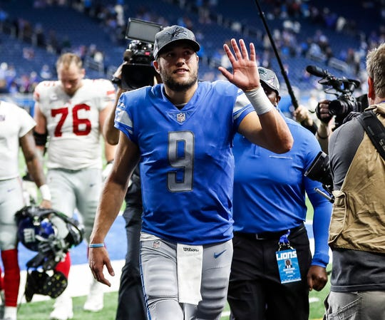 Matthew Stafford waves at fans after the Lions won 31-26 over the Giants at Ford Field in Detroit, Sunday, Oct. 27, 2019.