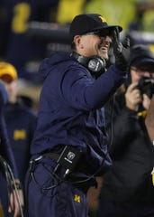 Michigan Wolverines coach Jim Harbaugh celebrates during the second half against Notre Dame on Saturday, Oct. 26, 2019 at Michigan Stadium in Ann Arbor.