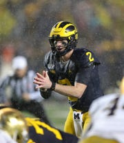 Michigan Wolverines quarterback Shea Patterson runs the offense against Notre Dame during the first half Saturday, Oct. 26, 2019 at Michigan Stadium in Ann Arbor.