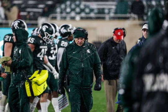 Michigan State coach Mark Dantonio walks off the field after speaking to players at a timeout during the second half against Penn State at Spartan Stadium in East Lansing, Saturday, Oct. 26, 2019.
