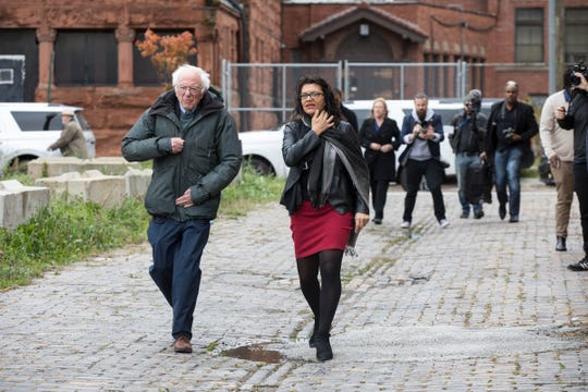 U.S. Senator and presidential candidate Bernie Sanders tours Detroit with U.S. Rep. Rashida Tlaib near Little Caesars Arena in Detroit on Sunday.