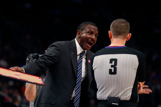 Detroit Pistons coach Dwane Casey argues a call with referee Nick Buchert during the first half against the Philadelphia 76ers, Saturday, Oct. 26, 2019, in Detroit.