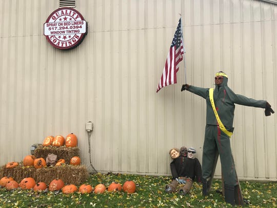 The scarecrow displayed outside Quality Coatings in Fowlerville on Sunday, Oct. 27.